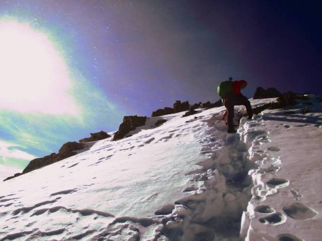 """Climbing the snowfield towards the bulk of """"Drift"""", and the infamous Notch."""